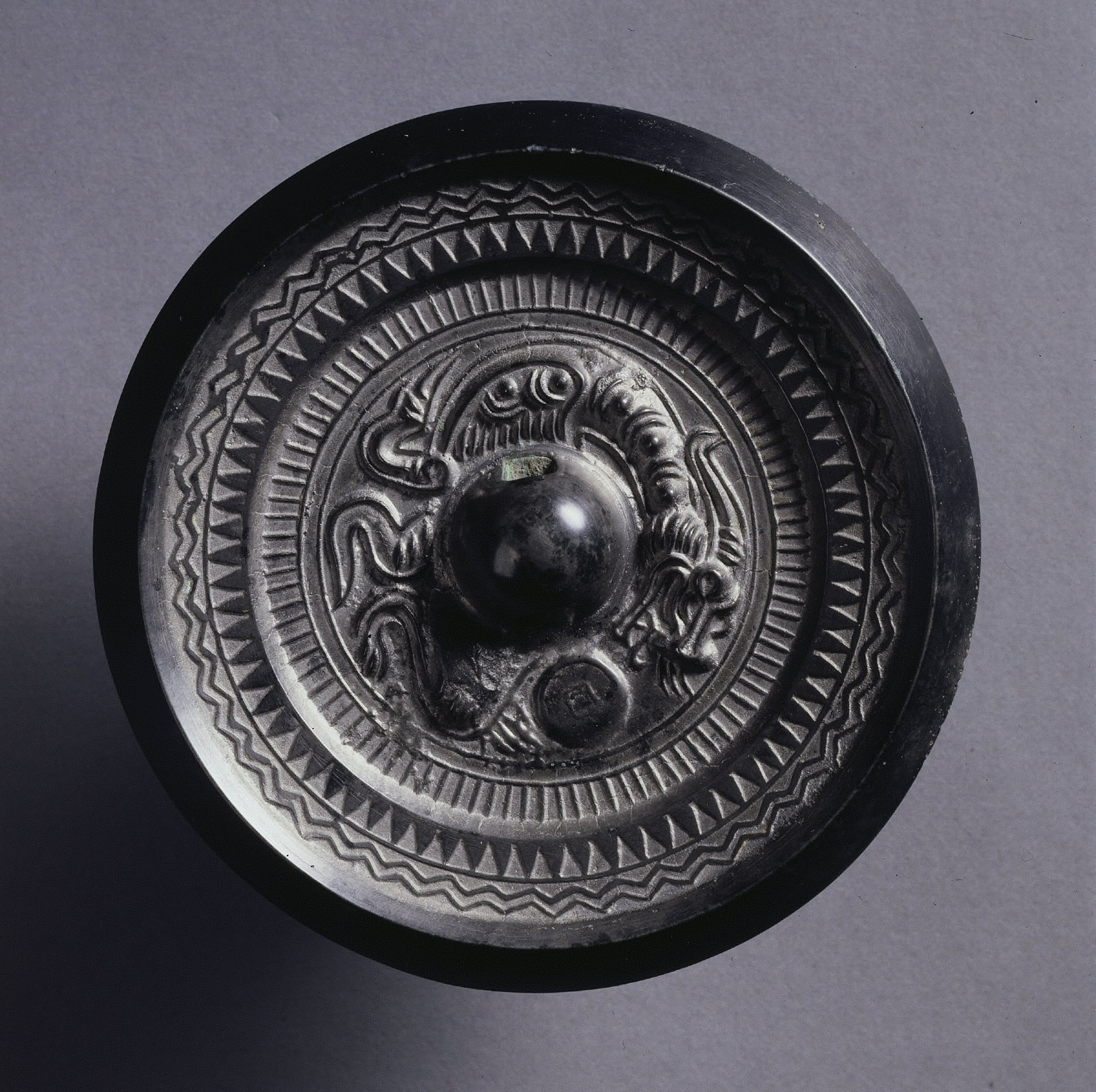 Mirror with Dragon and Concentric Band Design