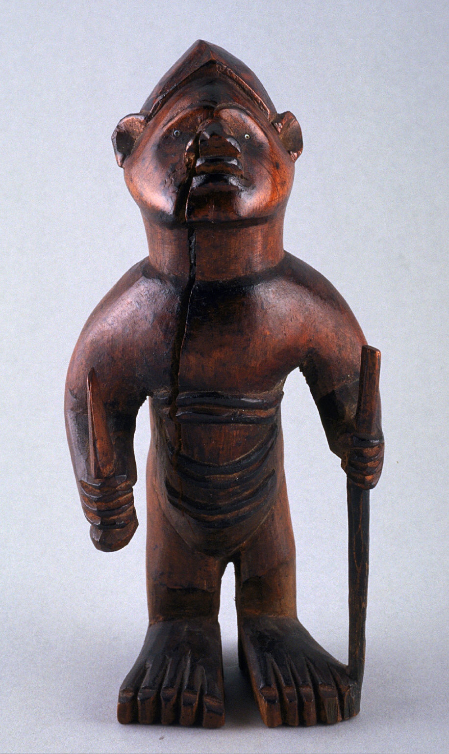 Standing male with staff and trowel
