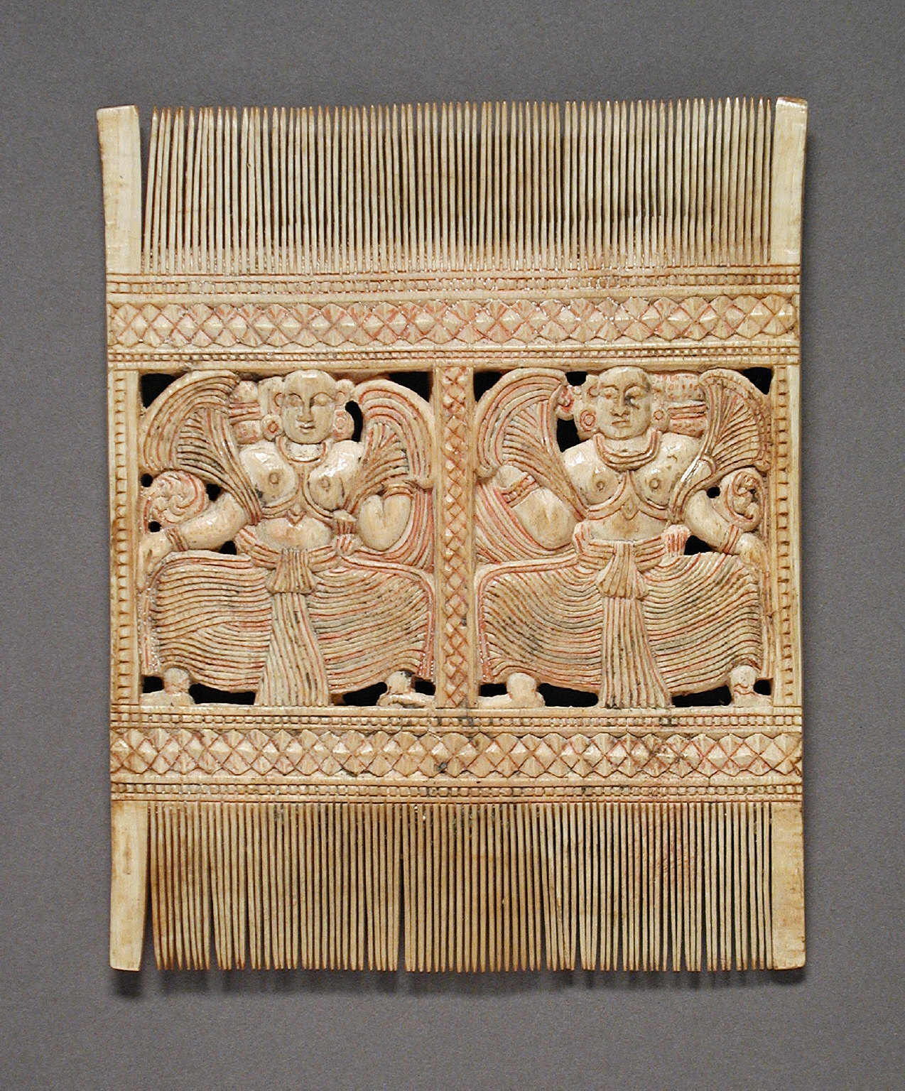 Comb with Two Women