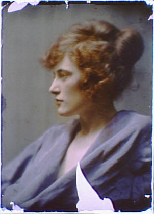 Woman with red hair wearing a blue robe or gown