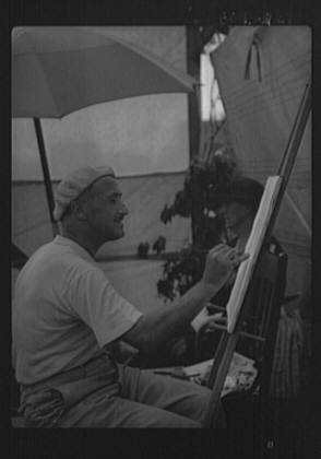 Man seated outdoors painting, Easthampton, Long Island