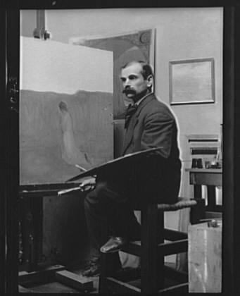 Unidentified man, seated at his easel, portrait photograph