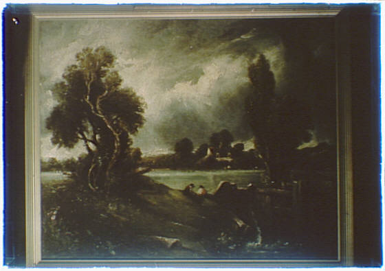Photograph of a painting of a landscape under a stormy sky