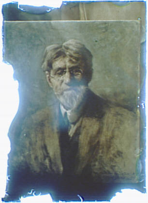 Photograph of a painting of a bearded man wearing glasses