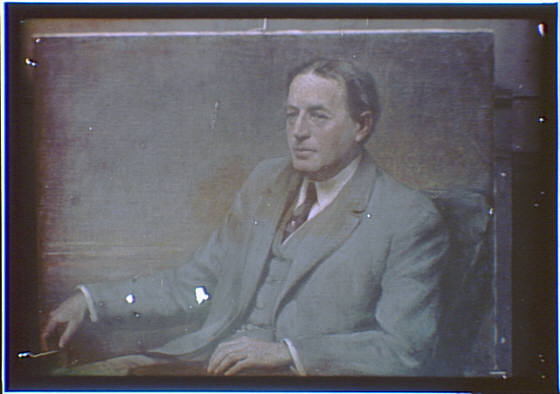 Photograph of a painting of a man in a gray suit seated in a chair