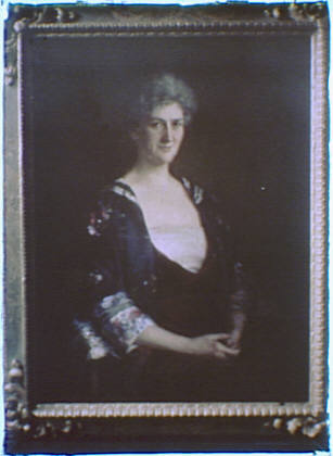 Photograph of a painting of a woman with folded hands