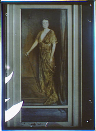 Photograph of a painting of a woman standing and holding a walking stick or cane